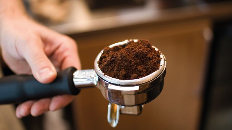 A portafilter heaped with ground coffee
